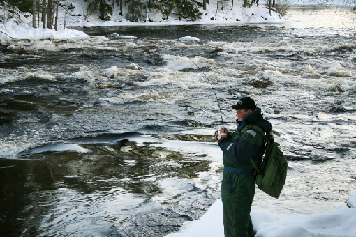 The fishing season stretches throughout the winter on the Kapeenkoski Rapids, Laukaa.