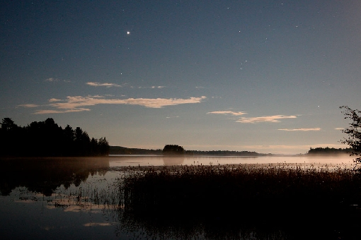 In autumn Jupiter shines over the fishing waters of Finnish Lake District.