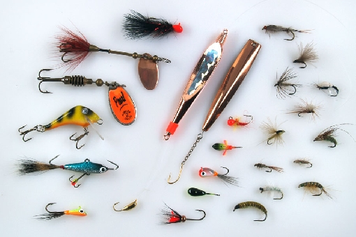 Whitefish lures. Left vertical row: MA Mini-Leech, Myr, Rublex Celta, Seniori, small balanced lure and MA Mikro-Mutu. In the middle: two vertical jigs and different kind of mormyshkas. In the right: flies for whitefish.