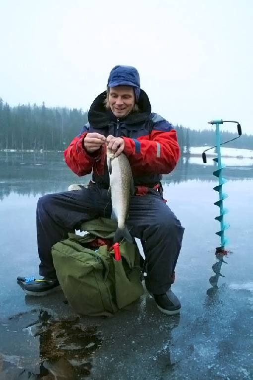 Big whitefish is a dream catch in ice fishing.